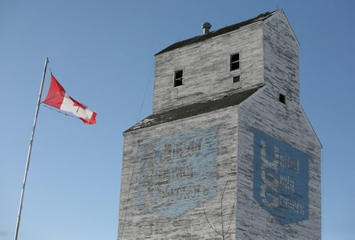 Brandon Sun 21112008 A canadian flag flaps in the wind in front of the last grain elevator in Oak River, Man. before the elevator is knocked down on Friday, November 21, 2008. The United Grain Growers elevator opened in 1958 and at one time the town housed six elevators. Now the grain elevator in Norman is the last elevator left in the municipality of Blanshard. It is still in use. (Tim Smith/Brandon Sun)