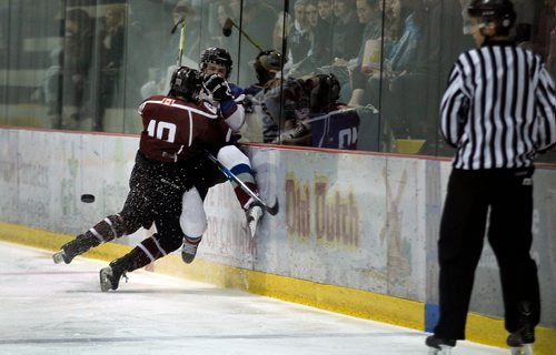 PHIL HOSSACK / WINNIPEG FREE PRESS -St Paul Crusader # 19 Ethan Lewis slams Sturgeon Heights Huskie  #13 Ethan Yewdall into the boards in the 3rd period of a hard hitting High School playoff game Wednesday. See Mike Sawatzky's story.   - February 28, 2018