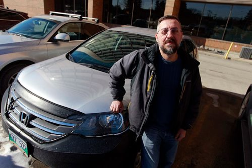 BORIS MINKEVICH / WINNIPEG FREE PRESS Evgeni Stamdolski poses next to his Honda that he is going to use as a TappCar driver. He is Manitoba's first TappCar driver. March 1, 2018