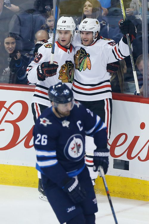 Chicago Blackhawks' Jonathan Toews (19) and Brandon Saad (20) celebrate Saad's goal against Blake Wheeler (26) and the Winnipeg Jets 11 seconds into the first period NHL action in Winnipeg on Thursday, March 15, 2018. THE CANADIAN PRESS/John Woods