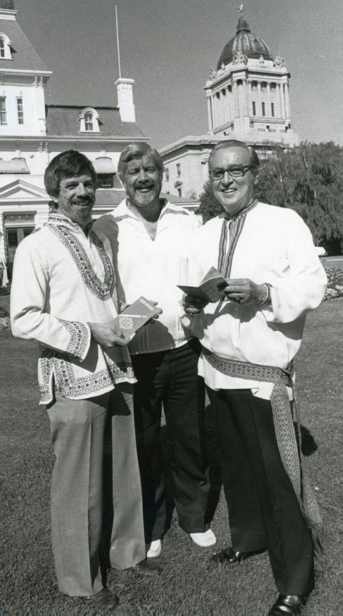 WAYNE GLOWACKI / WINNIPEG FREE PRESS FILES Image published July 30, 1980. Caption published with image: Folklorama chairman Sid Ritter (left), along with Aidan O' Brien (centre), president of the Community Folk Art Council of Winnipeg, presented Lt.-Gov. F.L. (Bud) Jobin with his passport to Folklorama '80 yesterday on the lawn of Government House. The festival runs from Aug. 10-16 and features 37 pavilions.