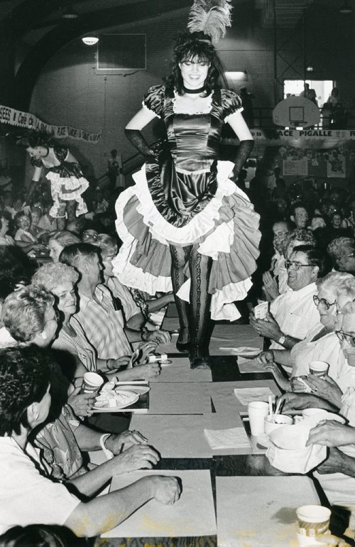 WAYNE GLOWACKI / WINNIPEG FREE PRESS FILES Image taken Aug. 9, 1987. Information on back on image: Can Can dancers make grand entrance by walking on table tops to the front of the stage.