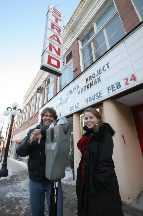 Brandon Sun Brandon Folk, Music and Arts Festival board members Jeff Fawcett and Shandra MacNeill, have brought a little life back to the former Strand Theatre marquee, which has been blank for half a decade, head-lining Juno nominee Hawksley Workman's show at the Road House later this month. (Bruce Bumstead/Brandon Sun)