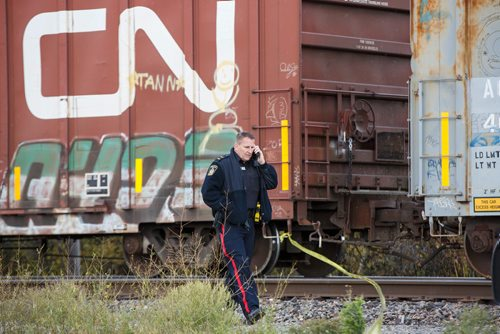 MIKE DEAL / WINNIPEG FREE PRESS Police at the scene of a CN rail line where a person was hit by a train close to Wilks Ave. and Shaftesbury Blvd. Friday morning. 180928 - Friday, September 28, 2018.