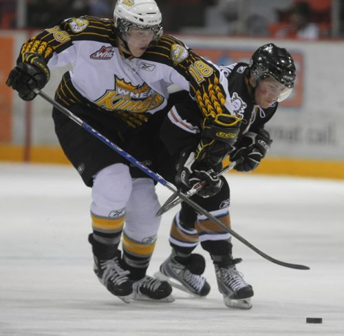 Brandon Sun Brandon Wheat Kings' Cale Jefferies, #18, and Kootenay Ice Christian Magnus, #9, race for a puck during the second period of Friday night's WHL playoff game at Westman Place. (Bruce Bumstead/Brandon Sun)