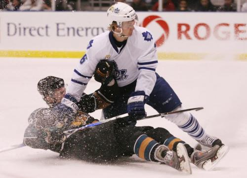 The Maniboa Moose's Alexandre Bolduc gets hauled down by the Toronto Marlies' Anton Stralman during the third period of AHL playoff action at the Ricoh Centre in Toronto, ON Sunday, April 19, 2009. Darren Calabrese for The Winnipeg Free Press