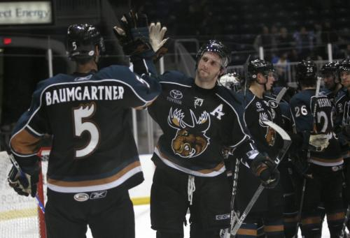 April 21, 2009, 2009 -  Manitoba Moose assistant captain Jason Jaffray celebrates with teammate Nolan Baumgartner following their 5-1 victory against the Toronto Marlies at the Ricoh Centre in Toronto on April 21, 2009.  Manitoba won the game 5-1. Photo by Colin O'Connor for The Winnipeg Free Press.