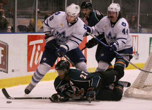 The Manitoba Moose's Maxime Fortunus is tripped by the Toronto Marlies' Jay Rosehill, left, and Ryan Hollweg  during the first period of AHL playoff action at the Ricoh Centre in Toronto, ON Thursday, April 23, 2009. Darren Calabrese for The Winnipeg Free Press