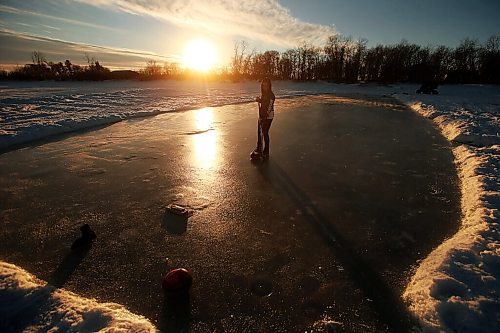 JOHN WOODS / WINNIPEG FREE PRESS Team Canada skip Kerri Einarson curls on her homemade rink on Lake Winnipeg north of Gimli Tuesday, January 12, 2021. Her father Jeff Flett made the rink so that Einarson could practice for the upcoming Scotties Tournament of Hearts in Calgary in February. Einarson uses rocks inscribed with her brother's name, Kyle, who died in a snowmobile accident.  Reporter: Bell