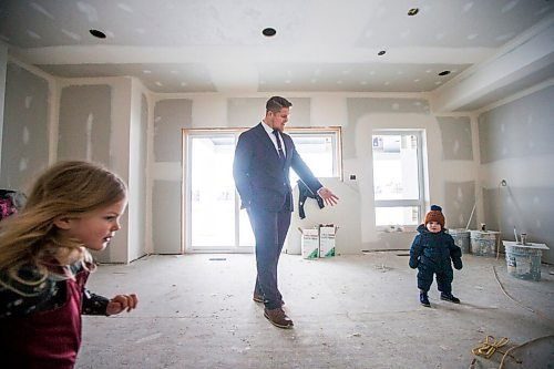 MIKAELA MACKENZIE / WINNIPEG FREE PRESS  Bombers linebacker Adam Bighill (centre) and his kids, Leah (three, left), and Beau (one), check out the new home they're building in Bridgwater in Winnipeg on Friday, Jan. 22, 2021. For Jason Bell story.  Winnipeg Free Press 2021