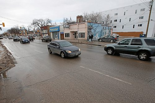 JOHN WOODS / WINNIPEG FREE PRESS Ellice Avenue in Winnipeg, Monday, February 22, 2021. West End businesses are finding business in the pandemic is hard.  Reporter: Durrani