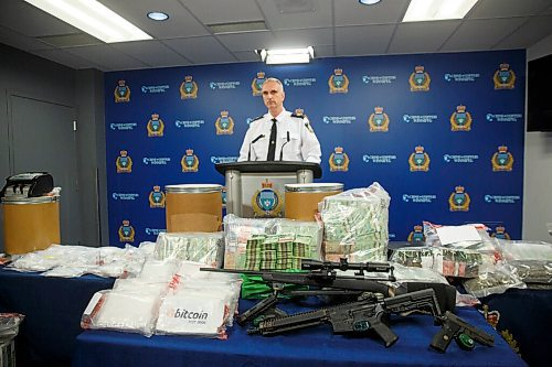 MIKE DEAL / WINNIPEG FREE PRESS Winnipeg Police Inspector Max Waddell announces that a major inter-provincial drug network was dismantled recently during what they have called Project Gold Dust. During the 10-month long investigation the police were able to confiscate among other things; 17 kilograms of cocaine (which the dealers were calling BitCoin), 21lbs of cannabis, $2million in cash, $107,000 in bit-coin, along with several guns which were on display at the police headquarters during the media conference Wednesday morning. 210224 - Wednesday, February 24, 2021.