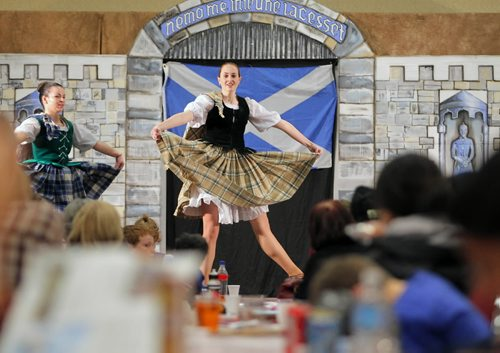 Brandon Sun 06022010 Visitors to the Scottish Pavilion watch Shona McHard and Heather McPhee of McHard School of Dance perform during the 7th Annual Lieutenant Governor's Winter Festival on Saturday. (Tim Smith/Brandon Sun)