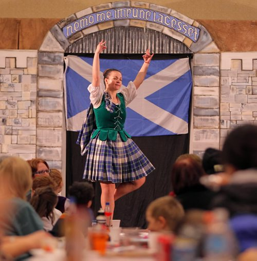 Brandon Sun 06022010 Visitors to the Scottish Pavilion watch Shona McHard of McHard School of Dance perform during the 7th Annual Lieutenant Governor's Winter Festival on Saturday. (Tim Smith/Brandon Sun)