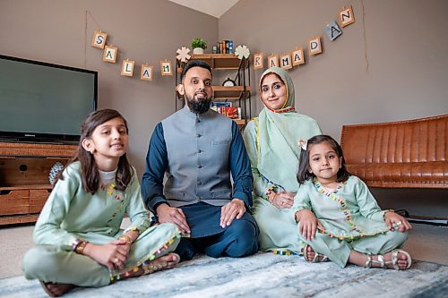 Daniel Crump / Winnipeg Free Press. (L to R) Ayza Waleed, Waleed Waleed, Asra Waleed and Sarah Waleed sit in front of their decorated ramadan corner in their living room. April 10, 2021.