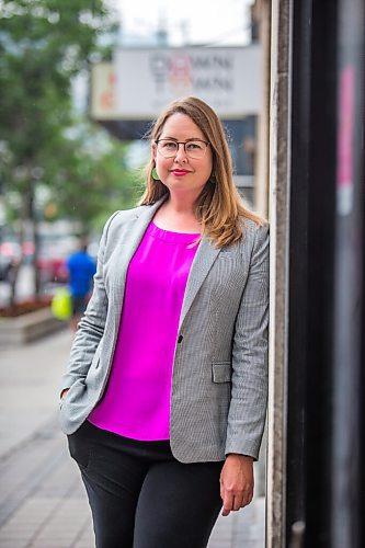 MIKAELA MACKENZIE / WINNIPEG FREE PRESS  Kate Fenske, executive director of the Downtown BIZ, poses for a portrait on Portage Avenue in Winnipeg on Tuesday, July 20, 2021. For Ben Waldman story. Winnipeg Free Press 2021.