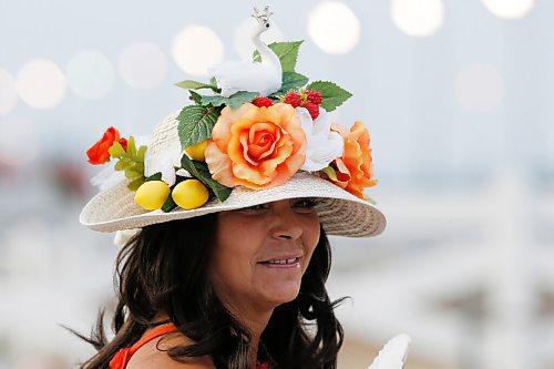 JOHN WOODS / WINNIPEG FREE PRESS Liana Denardi wears her fancy hat at Manitoba Derby day at the Assiniboia Downs Monday, August 2, 2021.   Reporter: ?