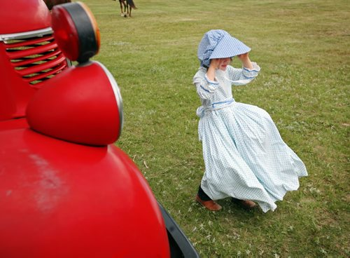 Brandon Sun Katie Wright walks past an antique truck during the 100th anniversary Rivers Agricultural Fair, Wednesday afternoon. (Colin Corneau/Brandon Sun)