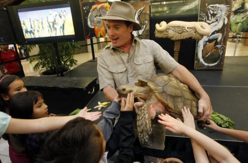 "BORIS.MINKEVICH@FREEPRESS.MB.CA  100909 BORIS MINKEVICH / WINNIPEG FREE PRESS Safari Jeff (Jeff McKay) puts on a traveleing reptile show called ""Living Wild"" at Kildonan Place Shopping Centre. The show runs until Sept 12th. Here the kids get their hands on Father Time, an African spurred tortoise."