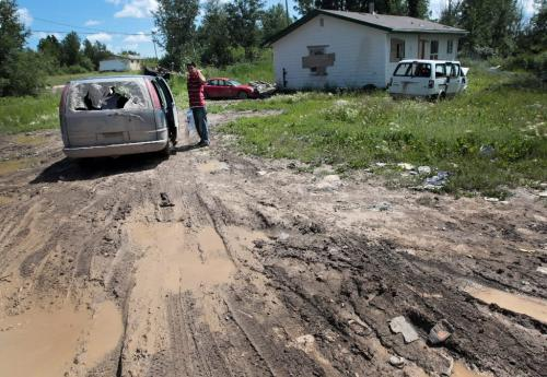 JOE.BRYKSA@FREEPRESS.MB.CA NO RUNNING WATER FEATURE-(See Helen's story)  -   Resident of  Garden Hill First Nation prepares to tackle the wet roads in his van to get some fresh water for his family. When it rains in the community, the roads are almost impassable July 2010, - JOE BRYKSA/WINNIPEG FREE PRESS