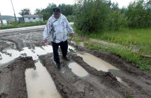 JOE.BRYKSA@FREEPRESS.MB.CA NO RUNNING WATER FEATURE-(See Helen's story)  -  Chris Taylor of Garden Hill First Nation shows condition of roads and explains why water truck has a hard time getting onto his property when the roads are wet- July 2010, - JOE BRYKSA/WINNIPEG FREE PRESS