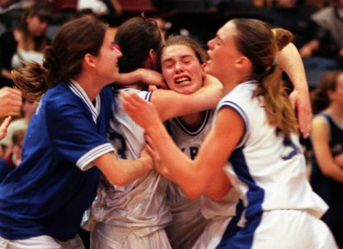 Sports-(See Ashley's story)- The Oak Park Raiders girls basketball team goes nuts  after winning the 1999 AAAA high school basketball championship against St Mary's academy saturday night at the Investors Athletic Center at University of Winnipeg- Joe Bryksa photo- Mar 20, 1999