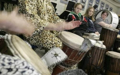"While Kevin Berthelette plays the balaphone, grade 10 students Lana Steak (centre) and Julie Oldershaw watch during an African drumming lesson at College Jeanne Sauve on Sunday afternoon. Berthelette, who is with the ""Tassu Percussion"" group, was instructing the students - who are part of Students Without Borders Afrique 2007 - part of the African culture. For story by Lindor Reynolds. Photo by Marianne Helm/Winnipeg Free Press"