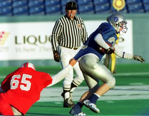 WAYNE GLOWACKI/WINNIPEG FREE PRESS Winnipeg High  School Football semi final at the Winnipeg Stadium. Oak Park Raiders vs Kelvin Clippers  Clippers  .  Clipper #65 Guy Page   can't hold on  to Raider  running back Alastair Fogg.  Ashley  Prest story .   Oct 27 2000